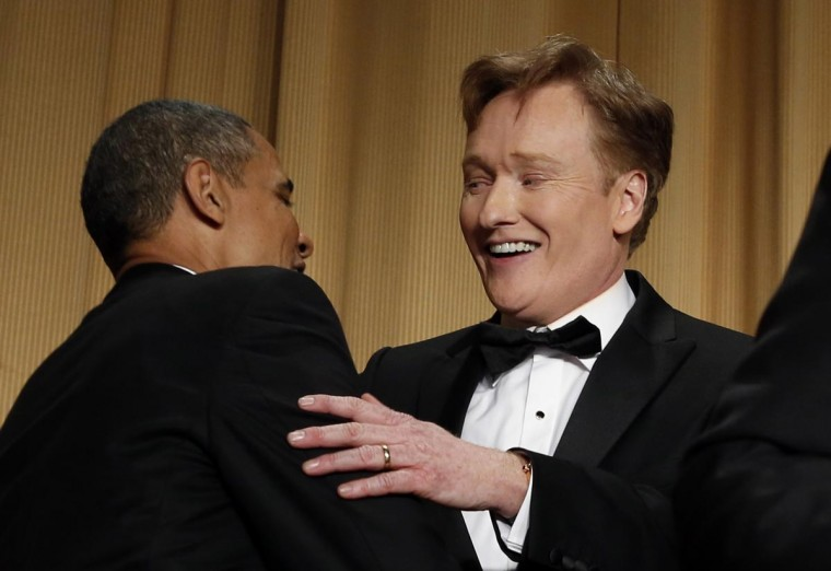 Comedian Conan O'Brien shakes hands with U.S. President Barack Obama after speaking at the White House Correspondents Association Dinner in Washington April 27, 2013. (Kevin Lamarque/Reuters)
