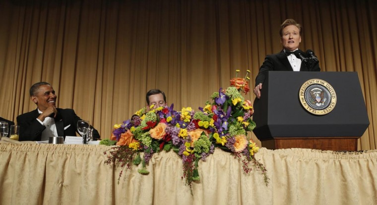 U.S. President Barack Obama listens as comedian Conan O'Brien speaks at the White House Correspondents Association Dinner in Washington April 27, 2013. (Kevin Lamarque/Reuters)