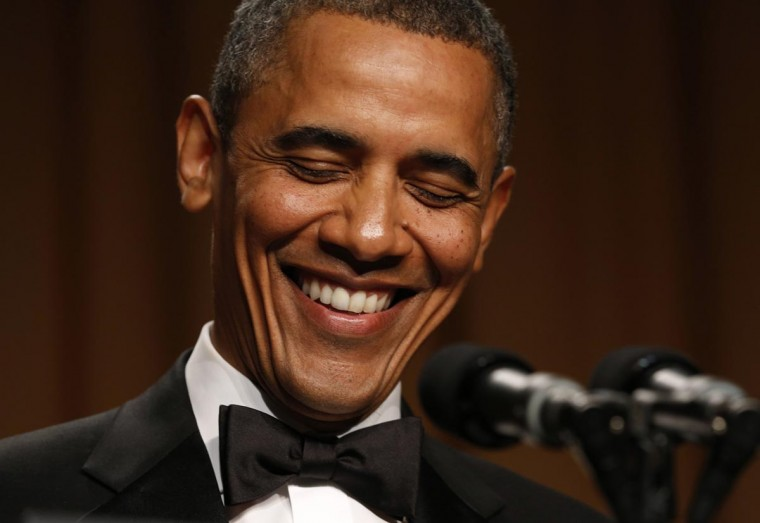 U.S. President Barack Obama laughs while speaking at the White House Correspondents Association Dinner in Washington April 27, 2013. (Kevin Lamarque/Reuters)
