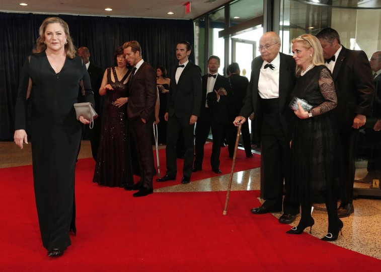 Actress Kathleen Turner (L) poses for the cameras as U.S. Representative John Dingell (D-MI) (2nd R) and his wife Debbie Dingell (R) arrive on the red carpet at the annual White House Correspondents' Association dinner in Washington April 27, 2013. (Jonathan Ernst/Reuters)