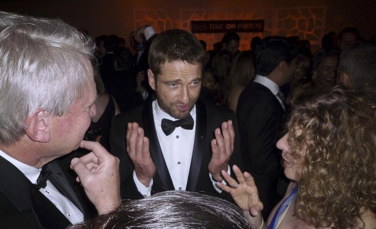 Scottish actor Gerard Butler talks with guests during a party before the annual White House Correspondents Association dinner in Washington April 27, 2013. (Jim Bourg/Reuters)
