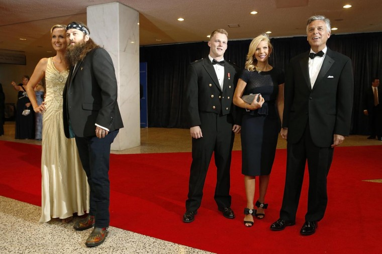 Korie Robertson (L) and Willie Robertson (2nd L) of reality TV series Duck Dynasty arrive on the red carpet next to former Republican presidential candidate Jon Huntsman (R), his wife Mary Kaye (2nd R) and their son Will (3rd R), at the annual White House Correspondents' Association dinner in Washington April 27, 2013. (Jonathan Ernst/Reuters)