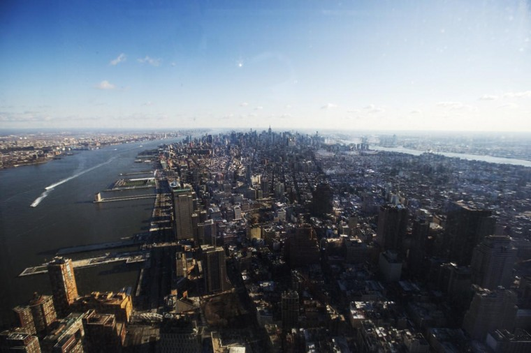 Southern Manhattan spreads out below the windows of the 100th floor observation deck in One World Trade Center in New York, April 2, 2013. Port Authority officials unveiled Tuesday the stunning view from the top of One World Trade Center, a 360-degree eagleís eye panorama that will instantly become one of the cityís premiere tourist attractions when it is completed in 2015. (Lucas Jackson/Reuters)