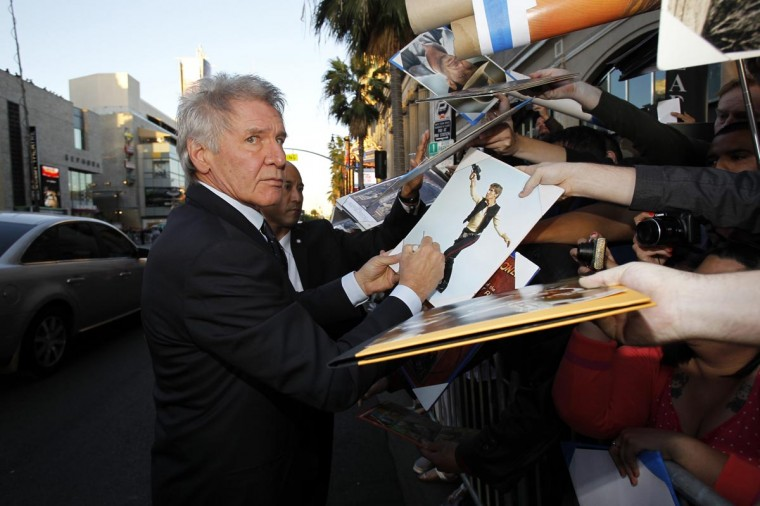 "Cast member Harrison Ford signs autographs at the premiere of ""42"" in Hollywood, California April 9, 2013. The movie opens in the U.S. on April 12. (Mario Anzuoni/Reuters)"