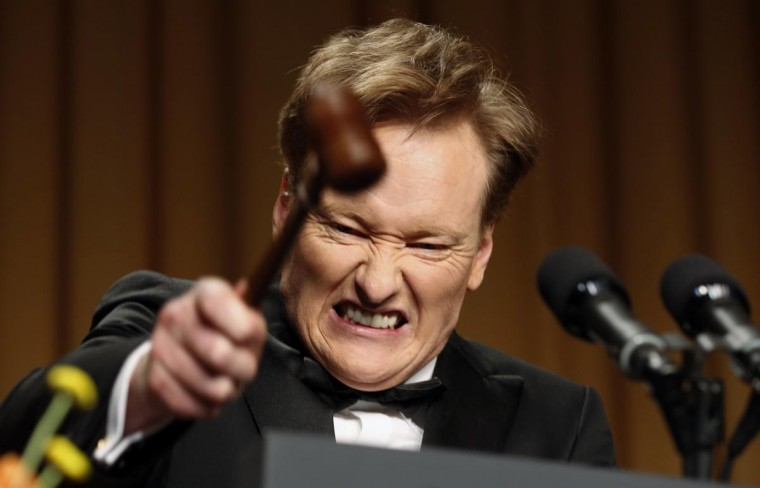 Comedian Conan O'Brien smashes a gavel as he speaks during the White House Correspondents Association Dinner in Washington April 27, 2013. (Kevin Lamarque/Reuters)