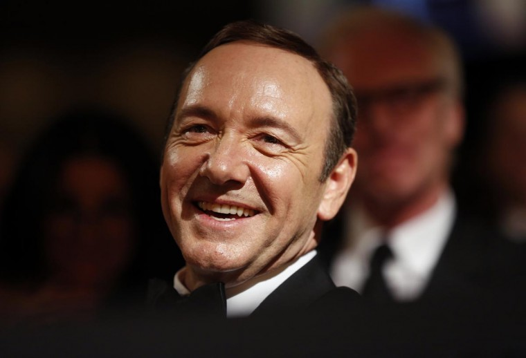 Actor Kevin Spacey listens to remarks at the White House Correspondents Association Dinner in Washington April 27, 2013. (Kevin Lamarque/Reuters)