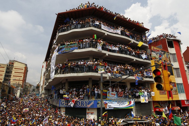 Supporters of Venezuela's opposition leader and presidential candidate Henrique Capriles attend a campaign rally in the state of Merida. Venezuelans will hold presidential elections on April 14. (Carlos Garcia Rawlins/Reuters photo)