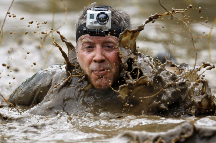 In 2012, a competitor wears a camera on his head as he competes in the Tough Mudder at Mt. Snow in West Dover, Vt. The Tough Mudder is a nine mile endurance event which runs competitors through a military style obstacle course complete with mud, water and fire. (Jessica Rinaldi/Reuters)