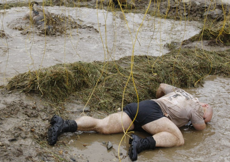 In 2012, a competitor reacts after being zapped by an electrified wire during the Tough Mudder at Mount Snow in West Dover, Vt. The Tough Mudder is a nine mile endurance event which runs competitors through a military style obstacle course complete with mud, water and fire. (Jessica Rinaldi/Reuters)