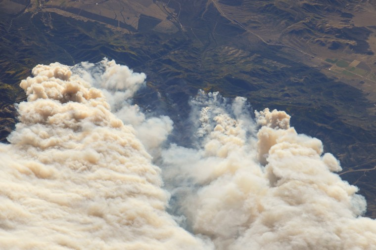 The Twitchell Canyon Fire, near central Utah's Fishlake National Forest, was reported to cover approximately 13,383 hectares (134 square kilometers, or 33,071 acres) as of September 21, 2010. The crew on the International Space Station (ISS) took this photograph of the smoke plumes generated by fires close to the southwestern edge of the burned area. The fire was started by a lightning strike on July 20, 2010. The photograph is highly oblique; that is, it was taken at an angle rather than looking straight down towards the Earth's surface (a nadir view). NASA image
