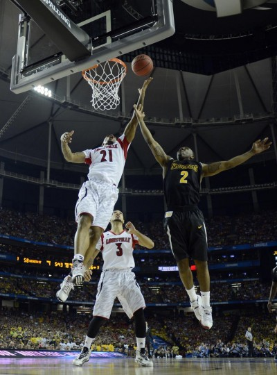 Louisville Cardinals forward Chane Behanan (21) reaches for a rebound against Wichita State Shockers guard Malcolm Armstead (2) in the second half of the semifinals during the 2013 NCAA mens Final Four at the Georgia Dome. (Robert Deutsch/USA TODAY Sports)
