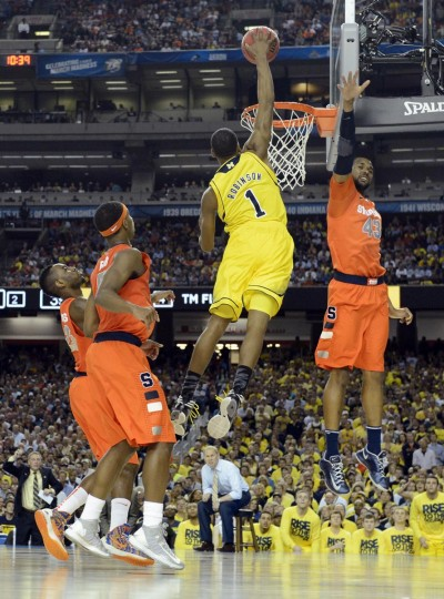Michigan Wolverines forward Glenn Robinson III (1) dunks over Syracuse Orange forward James Southerland (43) in the second half of the semifinals during the 2013 NCAA mens Final Four at the Georgia Dome. (Robert Deutsch/USA TODAY Sports)