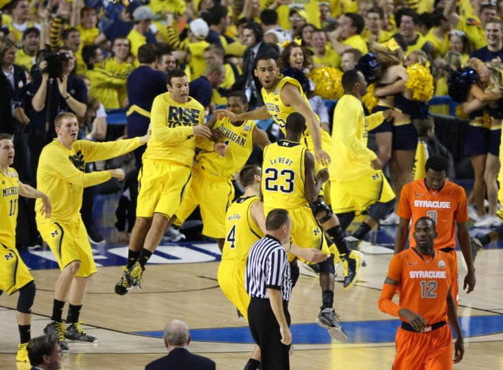 Michigan Wolverines celebrate their 61-56 win at the end of the second half of the semifinals during the 2013 NCAA mens Final Four at the Georgia Dome. (Daniel Shirey/USA TODAY Sports)