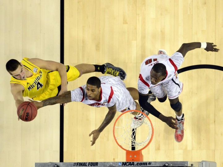 Michigan Wolverines forward Mitch McGary (4) shoots against Louisville Cardinals forward Chane Behanan (21) and center Gorgui Dieng (10) during the second half of the championship game in the 2013 NCAA mens Final Four at the Georgia Dome. (Bob Donnan/USA TODAY Sports)