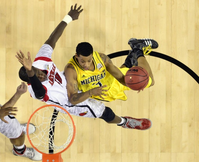 Michigan Wolverines guard Trey Burke (3) drives to the basket against Louisville Cardinals center Gorgui Dieng (10) during the second half of the championship game in the 2013 NCAA mens Final Four at the Georgia Dome. (Bob Donnan/USA TODAY Sports)