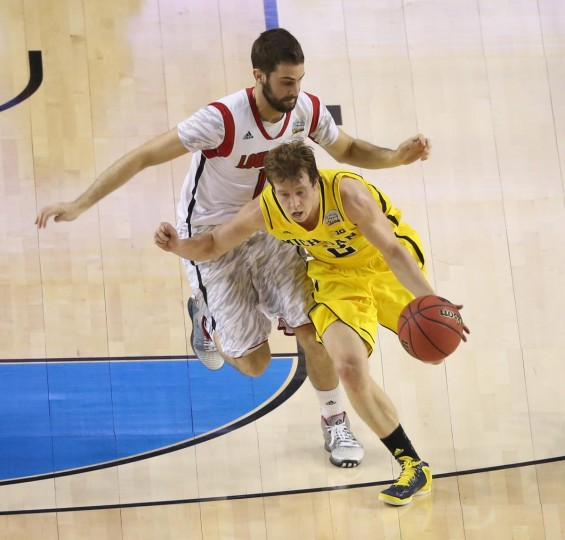 Michigan Wolverines guard Spike Albrecht (2) drives as Louisville Cardinals guard/forward Luke Hancock (11) defends during the first half of the championship game in the 2013 NCAA mens Final Four at the Georgia Dome. (Daniel Shirey/USA TODAY Sports)