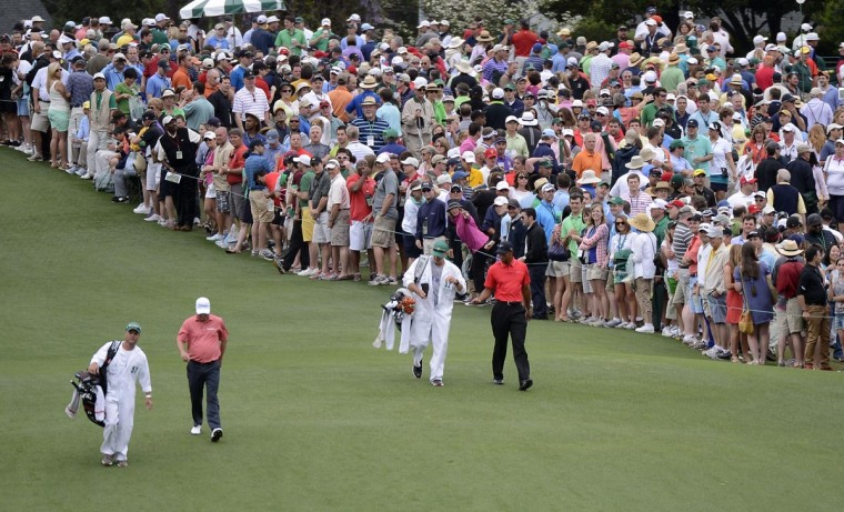 Tiger Woods and Tim Clark walk up the 1st fairway during the final round of the 2013 The Masters golf tournament at Augusta National Golf Club. (Michael Madrid/USA TODAY Sports)