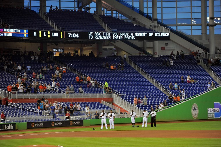 Miami Marlins players take a moment of silence before their game against the Washington Nationals at Marlins Park. (Steve Mitchell-USA TODAY Sports)