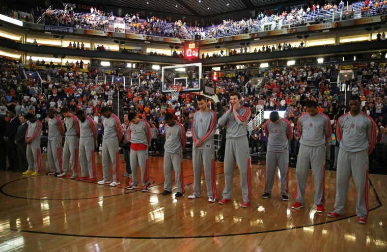Phoenix, AZ, USA: Houston Rockets players observe a moment of silence in memory of the Boston Marathon bombings prior to the game against the Phoenix Suns at the US Airways Center. (Mark J. Rebilas/USA TODAY Sports)