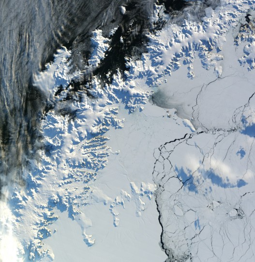 Sunny skies and westerly winds prevailed over the Antarctic Peninsula on April 24, 2012. Cloudy weather had just moved out, and temperatures rose well above freezing as the Moderate Resolution Imaging Spectroradiometer (MODIS) on NASAÕs Terra satellite passed overhead and captured a natural-color image (top). The relatively warm conditions on the peninsula in late April 2012 were driven in part by warm downslope winds, known as Chinook or foehn winds, that were channeled through valleys such as the one holding the Flask Glacier. Such winds can lead to extensive melt in the summer. NASA image