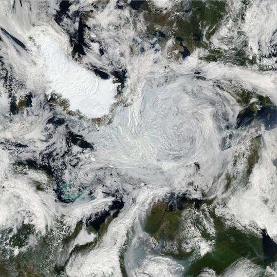 """An unusually strong storm formed off the coast of Alaska on August 5, 2012, and tracked into the center of the Arctic Ocean, where it lingered for several days. The Moderate Resolution Imaging Spectroradiometer (MODIS) aboard the Aqua satellite captured this natural-color image on August 7, 2012. The center of the storm was located in the middle of the Arctic Ocean at the time. The storm had an unusually low central pressure area. """"It's an uncommon event, especially because it's occurring in the summer,"""" said Paul Newman, chief scientist for atmospheric sciences at NASA's Goddard Space Flight Center. """"Polar lows are more usual in the winter."""" Newman estimated that there have only been about eight storms of similar strength during the month of August over the past 34 years of satellite records. NASA image"""