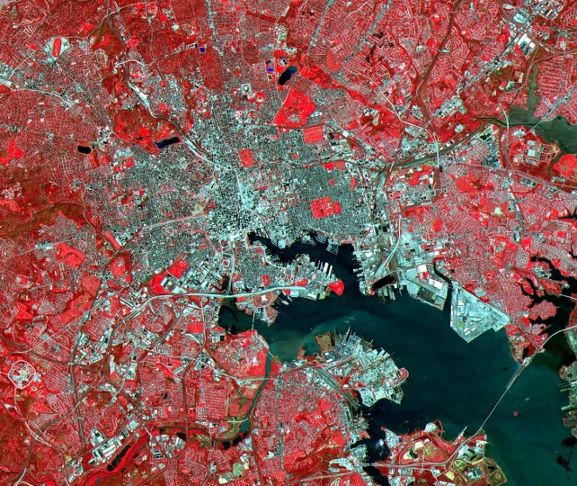 This Advanced Spaceborne Thermal Emission and Reflection Radiometer (ASTER) image of Baltimore was acquired on April 4, 2000, and covers an area of 17 by 20 km. Combining green, red, and near-infrared light to create a false-color composite, the image shows vegetation as red, water as blue, and urban areas as grey.