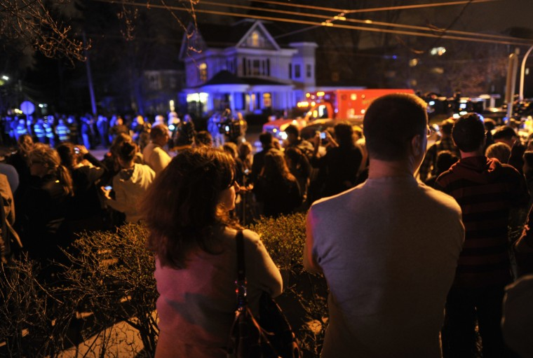 Residents await the capture of the second of two suspects wanted in the Boston Marathon bombings April 19, 2013 in Watertown, Massachusetts. Thousands of heavily armed police staged an intense manhunt for a Chechen teenager suspected in the Boston marathon bombings with his brother, who was killed in a shootout. Dzhokhar Tsarnaev, 19, defied the massive force after his 26-year-old brother Tamerlan was shot and suffered critical injuries from explosives believed to have been strapped to his body. (Timothy Clary/Getty Images)
