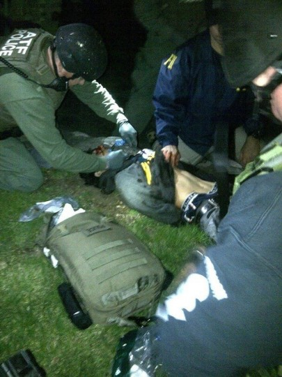 Boston marathon bombing suspect Dzhokhar Tsarnaev is treated by an ATF medic as he is taken into custody after being found hiding in a boat in Watertown, Massachusetts. (Photo via Twitter)