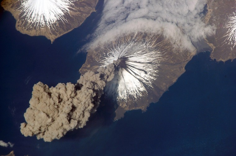 At 3:00 p.m. Alaska Daylight Time on May 23, 2006, Flight Engineer Jeff Williams from International Space Station (ISS) Expedition 13 contacted the Alaska Volcano Observatory (AVO) to report that the Cleveland Volcano had produced a plume of ash. Shortly after the activity began, he took this photograph. This picture shows the ash plume moving west-southwest from the volcano's summit. A bank of fog (upper right) is a common feature around the Aleutian Islands. The event proved to be short-lived; two hours later, the plume had completely detached from the volcano (see image from May 24). The AVO reported that the ash cloud height could have been as high as 6,000 meters (20,000 feet) above sea level. Cleveland Volcano, situated on the western half of Chuginadak Island, is one of the most active of the volcanoes in the Aleutian Islands, which extend west-southwest from the Alaska mainland. NASA photo