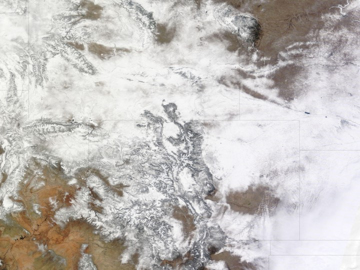 Following on the heels of another storm, heavy snow fell on Colorado and neighboring states on February 24, 2013. On February 25, the Denver/Boulder Forecast Office of the National Weather Service reported preliminary snow - totals including 27.2 inches west of Denver - and blizzard conditions to the east. Like the previous storm, this one continued moving eastward. NASA image