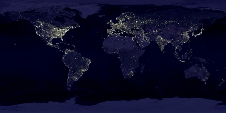 This image of Earth's city lights was created with data from the Defense Meteorological Satellite Program (DMSP) Operational Linescan System (OLS). Originally designed to view clouds by moonlight, the OLS is also used to map the locations of permanent lights on the Earth's surface. The brightest areas of the Earth are the most urbanized, but not necessarily the most populated. (Compare western Europe with China and India.) Cities tend to grow along coastlines and transportation networks. Even without the underlying map, the outlines of many continents would still be visible. The United States interstate highway system appears as a lattice connecting the brighter dots of city centers. In Russia, the Trans-Siberian railroad is a thin line stretching from Moscow through the center of Asia to Vladivostok. The Nile River, from the Aswan Dam to the Mediterranean Sea, is another bright thread through an otherwise dark region. NASA image
