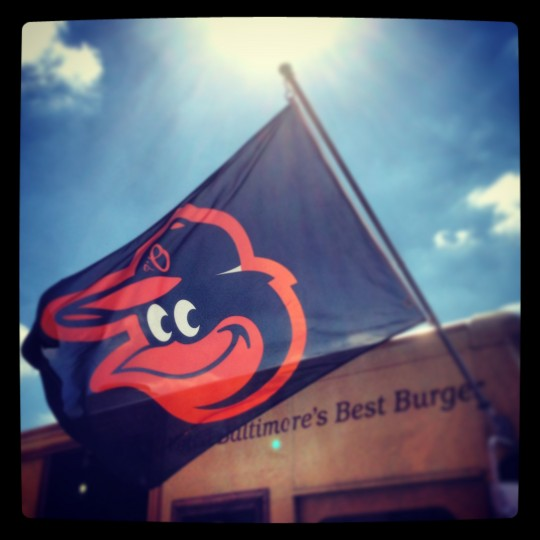 An Orioles flag flies from the Kooper's Chowhound Burger Wagon outside The Routunda in Hampden. Lifelong Baltimore resident Greg Freedman of Mt. Washington