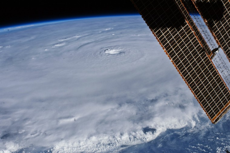 The relatively placid view from the International Space Station belied the potent forces at work in Hurricane Earl as it hovered over the tropical Atlantic Ocean on August 30, 2010. With maximum sustained winds of 135 miles (215 kilometers) per hour, the storm was classified as a category 4 on the Saffir-Simpson hurricane scale as it passed north of the Virgin Islands. In this photograph captured with a digital SLR camera by NASA astronaut Douglas Wheelock, Earl had a distinct eye that spanned about 17 miles (28 kilometers). Most of the storm had a seemingly uniform top, though the bottom edge of the image gives some sense of the towering thunderheads forming over the ocean. The solar panels of the ISS remind us that the sun is still shining, at least on ISS Expedition 24.