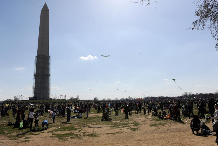 The Washington Monument towers over the Blossom Kite Festival on Saturday afternoon, March 30. (Jon Sham/Baltimore Sun Media Group)