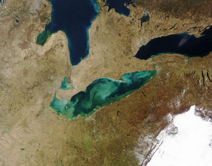 After a nearly ice-free winter, Lake Erie was filled with swirls of suspended sediment and algae on the first day of spring 2012. The Moderate Resolution Imaging Spectroradiometer (MODIS) on NASAÕs Terra satellite captured this natural-color image at 16:25 a.m. Central Daylight Time on March 21, 2012. Muddy, tan-colored water along the shoreline reveals sediment that has washed out of the rivers and streams that feed the lake. Milky green, light blue, and white shades may also be sediment-rich waters. As the shallowest of the Great Lakes, Erie's bottom can be stirred up by strong spring winds and the currents they generate. The lake bottom is rich in quartz sand and silt, as well as calcium carbonate (chalk) from limestone. NASA image