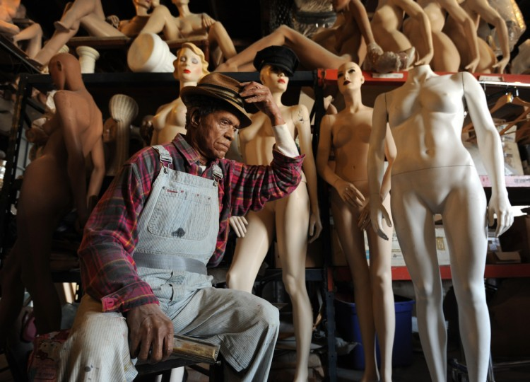 The life cast figure of the man in the foreground is one of artist Lania D'Agostino's favorite figures she created, beginning with an actual person followed by several steps in creating a mold of the person to cast. Surrounding the cast figure are mannequins she uses for movie set rentals and some of the museum projects -not for her personal artwork. (Algerina Perna/Baltimore Sun)