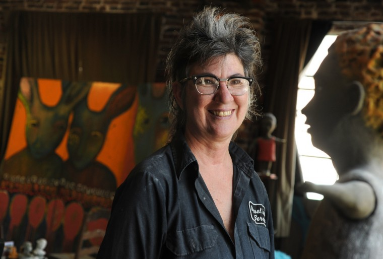 """Artist Lania D'Agostino is pictured in her studio. The rabbit figures behind her are part of her Jackrabbit series. The sculpture at right is a sculpture from her series called, """"Childhood Dreams, Memories and Deja Vu."""" (Algerina Perna/Baltimore Sun)"""