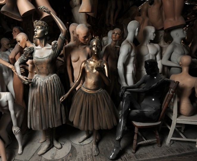 """The ballerina in the center is a life cast figure of Anais, age 11, made by her mother, artist Lania D'Agostino. The taller ballerina at left is a mannequin re-built by D'Agostino. The latter was part of a mall Christmas project with the """"Twelve Days of Christmas"""" theme. Surrounding the two ballerinas are mannequins she uses for movie set rentals and some of the museum projects -not for her artwork. (Algerina Perna/Baltimore Sun)"""