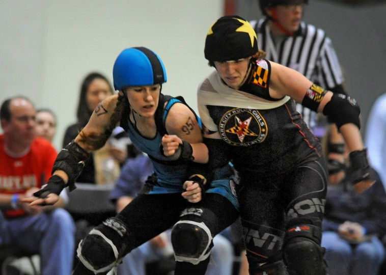 Philly Roller Girls' Liberty Belles' pivot, Ginger Vitis, left, jockeys for position again Charm City Roller Girls' All Stars jammer, I.M. Pain, right. (Amy Davis / Baltimore Sun)