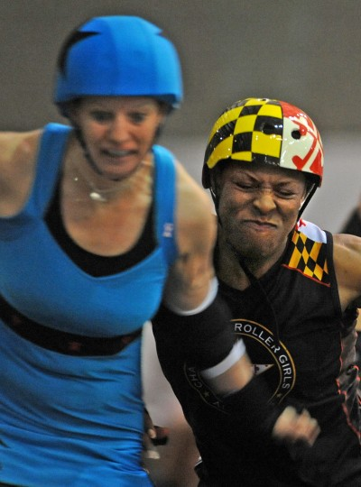 Uvetta Work of the Charm City Roller Girls' All Stars, right, tries to derail Philly jammer Devoida Mercy of the Liberty Belles. (Amy Davis / Baltimore Sun)