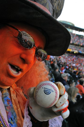 """Orioles fan Billy """"Billyho"""" Holebas of Arbutus participates in his 37th consecutive opening day with his first Opening Day baseball souvenir at the Baltimore Orioles' home opener. (Karl Merton Ferron/Baltimore Sun)"""