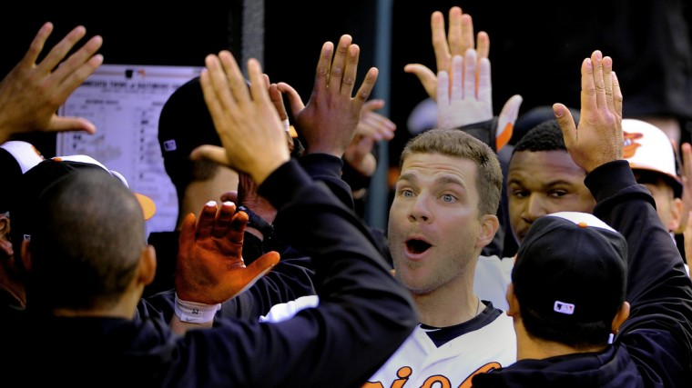 Chris Davis reacts to his teammates after his grand slam home run in the 8th inning, giving Baltimore the 9-5 win. (Gene Sweeney Jr./Baltimore Sun)