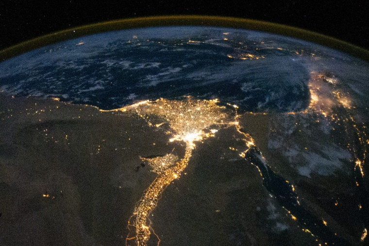 One of the fascinating aspects of viewing Earth at night is how well the lights show the distribution of people. In this view of Egypt, we see a population almost completely concentrated along the Nile Valley, just a small percentage of the country's land area. The Nile River and its delta look like a brilliant, long-stemmed flower in this astronaut photograph of the southeastern Mediterranean Sea, as seen from the International Space Station. The Cairo metropolitan area forms a particularly bright base of the flower. The smaller cities and towns within the Nile Delta tend to be hard to see amidst the dense agricultural vegetation during the day. However, these settled areas and the connecting roads between them become clearly visible at night. NASA image