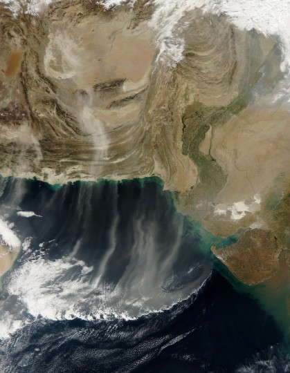 Dust plumes from Iran, Afghanistan, and Pakistan blew southward over the Arabian Sea in late December 2012. The Moderate Resolution Imaging Spectroradiometer (MODIS) on NASA's Aqua satellite captured this natural-color image of multiple dust storms on December 28. This region lies within a broad band of dust-producing terrain that stretches from the Sahara Desert to Mongolia. Sand seas often give rise to dust storms, and such sandy deserts occur over a large portion of southwestern Afghanistan. Much of the dust in this image, however, has arisen from dry lakes and riverbeds. NASA image