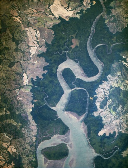 "This image is the first light from the new ISERV camera system, taken at 1:44 p.m. local time on February 16, 2013. It shows the Rio San Pablo as it empties into the Golfo de Montijo in Veraguas, Panama. It is an ecological transition zone, changing from agriculture and pastures to mangrove forests, swamps, and estuary systems. The area has been designated a protected area by the National Environmental Authority (ANAM) of Panama and is listed as a ""wetland of international importance"" under the Ramsar Convention. (Note that the image is rotated so that north is to the upper right.) NASA image"