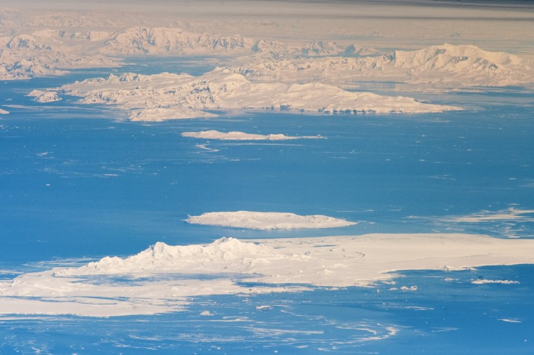 While the bulk of the continent of Antarctica sits over the South Pole, the narrow Antarctic Peninsula extends like a finger towards the tip of South America. The northernmost part of the Peninsula is known as Graham Land, a small portion of which (located at approximately 64 degrees South latitude) is visible at the top left in this astronaut photograph. Off the coast of Graham Land to the north-northwest, two of the South Shetland Islands—Livingston Island and Deception Island—are visible. Both have volcanic origins, and active volcanism at Deception Island has been recorded since 1800. (The last verified eruptive activity occurred in 1970.) NASA image