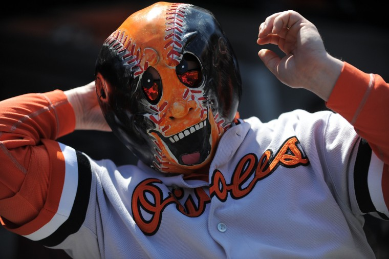 Jeff Springer from St. Mary's county, prepares his mask as he attends the home opener for the Baltimore Orioles as they face the Minnesota Twins. (Gene Sweeney Jr./Baltimore Sun)