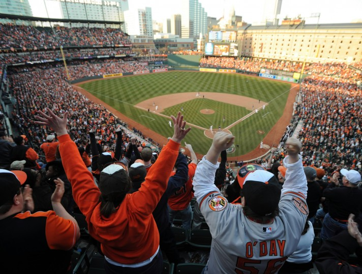 Fans reacts to Adam Jones single in the 8th that tied the game. (Jerry Jackson/Baltimore Sun)