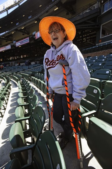 Ann Yetter, of Columbia, would not let her fractured tibia stop her from attending Orioles' opening day at Oriole Park at Camden Yards. So she decorated her crutches with black and orange tapes. (Kenneth K. Lam/Baltimore Sun)