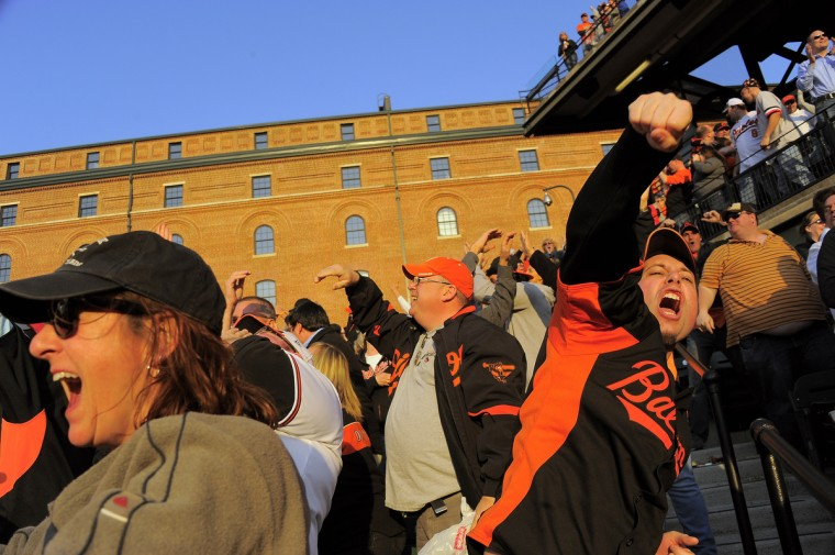 Orioles fans erupt as first baseman Chris Davis connects with a grand slam home run in the eighth inning of the Baltimore Orioles' home opener at Oriole Park at Camden Yards. It was the fourth home run in four games for Davis. (Karl Merton Ferron/Baltimore Sun)